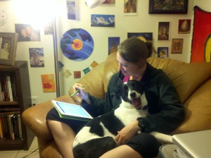 Sam with iPad and dog